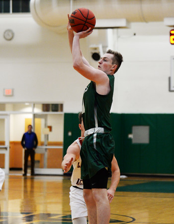 CARL RUSSO/staff photo. Brooks' George Smith of Salem NH takes the jump shot. Lawrence Academy at Brooks School in boys basketball action. 12/11/2019