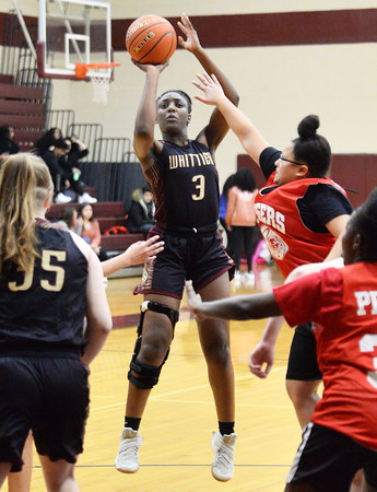 CARL RUSSO/Staff photo. Whittier's Grace Efosa takes the jump shot. Whittier Tech scrimmaged against Lynn Tech in girls basketball action Monday afternoon. 12/09/2019