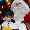 CARL RUSSO/Staff photo. Blake Chaves, 2 is not happy to have his photo taken with Santa. Andover held their annual Holiday Happenings downtown and at the town park Friday night. 12/13/2019