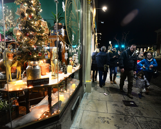 CARL RUSSO/Staff photo. A Christmas display decorates the window of Dovetail Apothecary of Beauty shop on Main Street. Andover held their annual Holiday Happenings downtown and at the town park Friday night. 12/13/2019