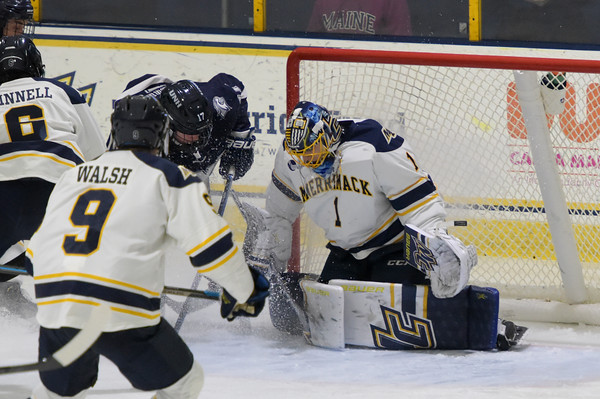 TIM JEAN/Staff photo <br /> <br /> Merrimack goaltender Jere Huhtamaa makes a save against UNH's Robby Griffin during the first period of a Mens Ice Hockey game at Merrimack College.    12/7/19