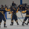 TIM JEAN/Staff photo <br /> <br /> Andover's Vanessa Pierni, center, is hugged by Hanna Medwar, as she celebrates scoring a goal with her teammates Laura Adams, left, and Sara Carleo, right, during a girls hockey game against Methuen/Tewksbury. Andover won 4-3 in overtime.     12/21/19