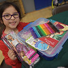 TIM JEAN/Staff photo <br /> <br /> Xochitl Santacruz, 7, shows off the presents she picked out during Haverhill's Boys & Girls Club annual Christmas party.     12/13/19