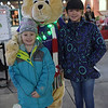 TIM JEAN/Staff photo <br /> <br /> Avery Couture, 6, of Merrimack, and her sister Bryce, 11, pose for a photo with the giant teddy bear from Claire's during the Methuen tree lighting festivities at The Loop shopping center.   12/7/19