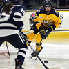 CARL RUSSO/Staff photo. Merrimack's Sam Lessick moves the puck in scoring position trying to get the Warriors on the board. The Merrimack College Warriors were defeated by the University of New Hampshire Wildcats in women's hockey action Friday night.12/06/2019