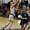 TIM JEAN/Staff photo <br /> <br /> Central's Claire Finney drives to the hoop over Pentuck's Greta Maurer during the Commonwealth Motors Christmas Classic basketball tournament. Pentuck defeated Central 38-36.  12/31/19
