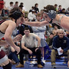 TIM JEAN/Staff photo <br /> <br /> Windham's Conner Sills, right, takes on Goffstown's Nathen Fowler during the Salem Blue Devil Classic wrestling tournament. Fowler won 3-2.        12/14/19