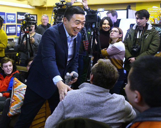 CARL RUSSO/Staff photo. Democratic presidential candidate Andrew Yang greets supporters as he enters Coffee Coffee in Salem to host a town hall meeting. 12/30/2019