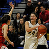 TIM JEAN/Staff photo <br /> <br /> Andover's Brooke Hardock, right, looks to pass the ball around Natick's Alana Ciccarelli during the Commonwealth Motors Christmas Classic basketball tournament. Natick defeated Andover 52-37.  12/31/19