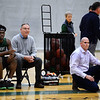 CARL RUSSO/staff photo. Brooks' head coach, John McVeigh, right, has his father, Michael McVeigh, former veteran head basketball coach for North Andover high as his assistant coach. Brooks Senior, Olu Oladitan is seated next to him. Lawrence Academy at Brooks School in boys basketball action. 12/11/2019