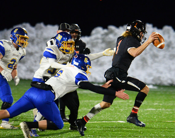 CARL RUSSO/Staff photo. Greater Lawrence quarterback, Shamil Diaz breaks tackles to find plenty of running room. Greater Lawrence Tech. defeated Assabet Valley 36-26 in State Vocational Bowl Thursday night. 12/05/2019
