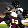 CARL RUSSO/Staff photo. Whittier defenders, Logan Raymond, 12 and Jeremias Collazo tackle Reggie quarterback, Franklyn Espinal as he tries to make yardage. Whittier Wildcats defeated the Greater Lawrence Reggies in Thanksgiving Eve football action. 11/27/2019