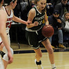 TIM JEAN/Staff photo <br /> <br /> Pentuck's Megan Reading, right, drives to the hoop past Central's Emily Downer during the Commonwealth Motors Christmas Classic basketball tournament. Pentuck defeated Central 38-36.  12/31/19