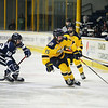 CARL RUSSO/Staff photo. Merrimack's Gabby Jones controls the puck. The Merrimack College Warriors were defeated by the University of New Hampshire Wildcats in women's hockey action Friday night.12/06/2019