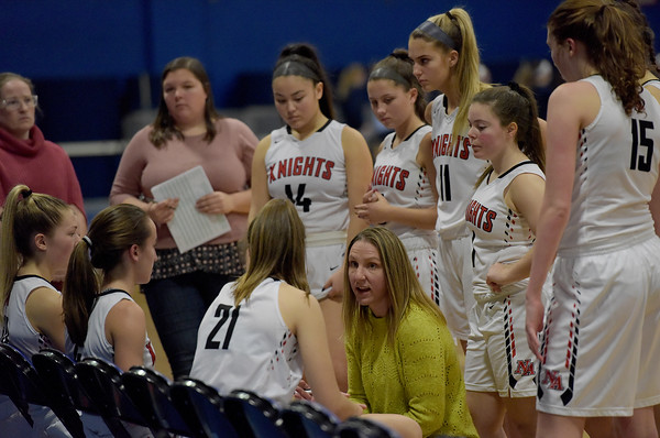 TIM JEAN/Staff photo <br /> <br /> North Andover head coach Jesalyn Devent talks with her team during a timeout against Natick during the Commonwealth Motors Christmas Classic basketball tournament.   12/28/19