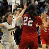 TIM JEAN/Staff photo <br /> <br /> Andover's Amelia Hanscom, left, defends Natick's Brenna McDonald during the Commonwealth Motors Christmas Classic basketball tournament. Natick defeated Andover 52-37.  12/31/19