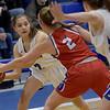 TIM JEAN/Staff photo <br /> <br /> Methuen's Stephanie Hendrick, left, looks to pass around Tewksbury's Julia Cafferty during a girls basketball game. Methuen lost 49-26.     12/19/19