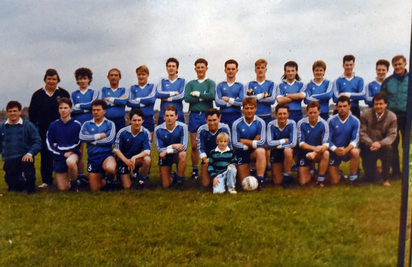 RYAN HUTTON/ Staff photo<br /> Peddler's Daughter owner Michael Conneely, front row second from right, in his younger days when he played Gaelic football.