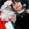 CARL RUSSO/Staff photo. STEPPING OUT:  Gianna Murphy, 13 of Methuen receives a Christmas present and hug from Santa.  <br /> <br /> The Holy Name Society of Corpus Christi Parish at Holy Rosary Church in Lawrence held its 59th. Annual Christmas Party for Exceptional Adults and Children on Sunday, December 1st. at the Parish Center. <br /> <br /> Over one hundred guest, family members and caregivers were treated to a Pasta and meatball dinner and a large Christmas cake for dessert. The highlight of the party was a visit from Santa who handed out Christmas gifts. The music was provided by The Holy Name Society's Christmas Party Band. 12/1/2019