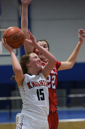 TIM JEAN/Staff photo <br /> <br /> North Andover's Katie Robie tries to shoot while being defended by Natick's Brenna McDonald during the Commonwealth Motors Christmas Classic basketball tournament.   12/28/19