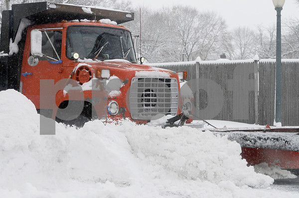 TIM JEAN/Staff photo <br /> <br /> A snowplow pushes the snow back off of Balmoral St., Andover during the second half of a long-duration snowstorm. 12/3/19