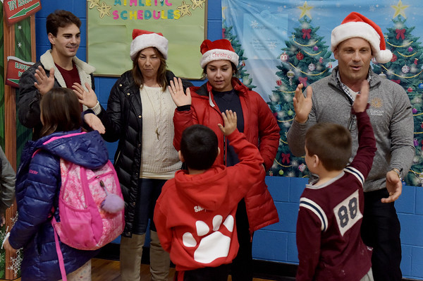 TIM JEAN/Staff photo <br /> <br /> The Faro family high fives children after they passed out gift cards to members of the Boys and Girls Club of Greater Salem. Standing from left to right are Max, Sammantha, Olivia, and Joe Faro.    12/18/19