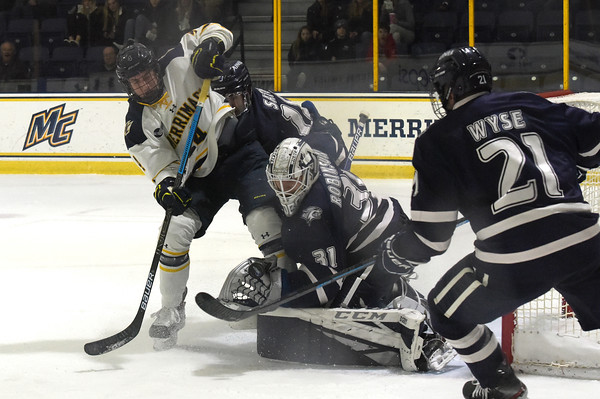 TIM JEAN/Staff photo <br /> <br /> Merrimack's Tyler Drevitch shoots the puck as UNH goaltender Mike Robinson makes the save during the first period of a Mens Ice Hockey game at Merrimack College.    12/7/19