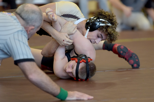 TIM JEAN/Staff photo <br /> <br /> Haverhill's Edgar Feliciano, top, wrestles against North Andover's Kris Rhoton in the 138 pound match.     12/24/19