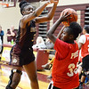 CARL RUSSO/Staff photo. Whittier's Grace Efosa plays tight defense. Whittier Tech scrimmaged against Lynn Tech in girls basketball action Monday afternoon. 12/09/2019