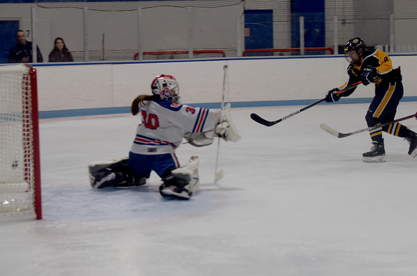 TIM JEAN/Staff photo <br /> <br /> Andover's Kalli Archambault shoots and scores against Methuen/Tewksbury goaltender Kaia Hollingsworth in overtime. Andover won 4-3.    12/21/19