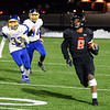 CARL RUSSO/Staff photo. Greater Lawrence's Franklyn Espinal sprints for the end zone. Greater Lawrence Tech. defeated Assabet Valley 36-26 in State Vocational Bowl Thursday night. 12/05/2019