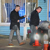 """CARL RUSSO/Staff photo. From left, Methuen police detective, Bill Kannan Jr., captain Kris McCarthy and officer Sean Fountain mark-off the area where shell casings from the shooting were found. <br /> <br /> An """"unknown assailant"""" shot a 24-year-old man while he was walking on Broadway Tuesday evening, police said. The victim was shot at several times and hit once, according to Detective Lt. Michael Pappalardo, who was at the scene investigating. The Fire Department transported the man to a local hospital for treatment of a non-life-threatening injury, Pappalardo said.The shooting happened at Broadway and Center Street at around 7:25 p.m. Multiple 911 calls reported the incident to police. Two hours after the shooting, the section of Broadway in front of the Sonrisa Market was blocked by crime scene tape. Part of Center Street was also closed as state and Methuen police officers investigated. Police """"recovered items of an evidentiary nature"""" at the scene, said Pappalardo, who didn't go into further details. No arrests had been made as of Tuesday night. Anyone with information about the shooting is asked to call Methuen police at 978-983-8698. The Massachusetts State Police Crime Scene Services Section assisted Methuen detectives with the investigation. 12/24/2019"""