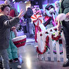 TIM JEAN/Staff photo <br /> <br /> Nathan Whitter, 5, of Haverhill, throws indoor snowballs towards a snowman to win a prize at Pentucket Bank's Santa's Village at Harbor Place during the Haverhill Chamber of Commerce annual Christmas Stroll in Haverhill.   12/6/19