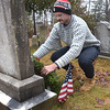 TIM JEAN/Staff photo <br /> <br /> George Davis, of Monson, MA., who has family in Haverhill places a wreath on a veterans grave during the Wreaths Across America remembrance day in Haverhill's Hilldale Cemetery.       12/14/19