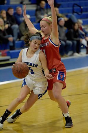 TIM JEAN/Staff photo <br /> <br /> Methuen's Stephanie Tardugno drives towards the hoop against Tewksbury's Alyssa Marchelletta during a girls basketball game. Methuen lost 49-26.     12/19/19