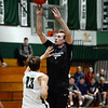 CARL RUSSO/Staff photo. North Andover's Kyle Moore takes the jump shot over Pentucket defender. North Andover defeated Pentucket in boys basketball scrimmage game Tuesday afternoon. 12/10/2019