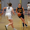RYAN HUTTON/ Staff photo<br /> Andover's Brooke Hardock drives downcourt as North Andover's Jackie Rogers rushes to intercept during the third period of Friday's game at North Andover.