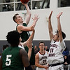 CARL RUSSO/staff photo. Brooks' George Smith of Salem NH sails to the hoop. Lawrence Academy at Brooks School in boys basketball action. 12/11/2019