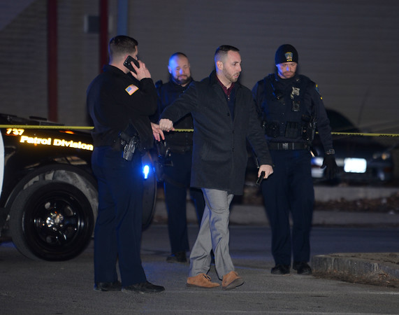 """CARL RUSSO/Staff photo. Methuen police detective, Bill Kannan Jr. and police officers investigate the shooting. <br /> <br /> An """"unknown assailant"""" shot a 24-year-old man while he was walking on Broadway Tuesday evening, police said. The victim was shot at several times and hit once, according to Detective Lt. Michael Pappalardo, who was at the scene investigating. The Fire Department transported the man to a local hospital for treatment of a non-life-threatening injury, Pappalardo said.The shooting happened at Broadway and Center Street at around 7:25 p.m. Multiple 911 calls reported the incident to police. Two hours after the shooting, the section of Broadway in front of the Sonrisa Market was blocked by crime scene tape. Part of Center Street was also closed as state and Methuen police officers investigated. Police """"recovered items of an evidentiary nature"""" at the scene, said Pappalardo, who didn't go into further details. No arrests had been made as of Tuesday night. Anyone with information about the shooting is asked to call Methuen police at 978-983-8698. The Massachusetts State Police Crime Scene Services Section assisted Methuen detectives with the investigation. 12/24/2019"""
