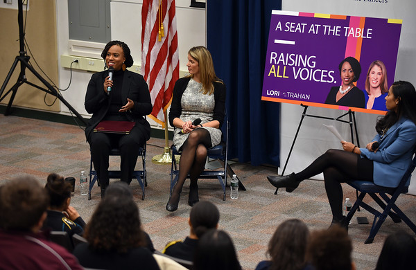 """RYAN HUTTON/ Staff photo<br /> Massachusetts Congresswoman Ayanna Pressley, left, speaks as fellow Congresswoman Lori Trahan, center, and former State Representative and current COO of MassINC Juana Matias, right, look on during a discussion at Lawrence High School on Friday entitled """"A Seat at the Table: Raising All Voices""""."""