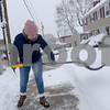 TIM JEAN/Staff photo <br /> <br /> Ynes Sanchez, a Lawrence school teacher clears snow away from the sidewalk near her home on Dartmouth St., Lawrence during the second half of a long-duration snowstorm.  12/3/19