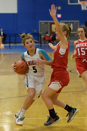 TIM JEAN/Staff photo <br /> <br /> North Andover's Norah Connors drives to the hoop against Natick's Laney Ross during the Commonwealth Motors Christmas Classic basketball tournament.   12/28/19