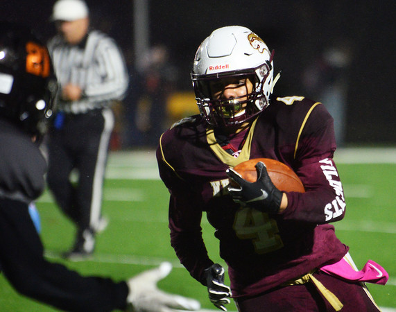 CARL RUSSO/Staff photo. Whittier's A.J. Espinal runs hard with the ball. Whittier Wildcats defeated the Greater Lawrence Reggies in Thanksgiving Eve football action. 11/27/2019