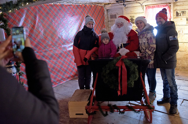 TIM JEAN/Staff photo <br /> <br /> The Cannata family of Wilmington visits with Santa for a photo at Smolak Farms in North Andover. Pictured from left are Asa, 13, Aurora, 3, Elena and Arjay Cannata.     12/21/19