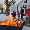 TIM JEAN/Staff photo <br /> <br /> Michael Wimmer, 14, of Boy Scout Troop 266 adds a piece of wood to the bonfire outside of the Windham Town Hall during the Windham Tree lighting celebration.   12/7/19