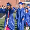 AMANDA SABGA/Staff photo<br /> <br /> Judith De La Cruz raises her hands as the graduates walk on to the field for Methuen High School's 2019 graduation ceremony on Nicholson Stadium.<br /> <br /> 6/7/19