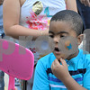 TIM JEAN/Staff photo<br /> <br /> Samual Morillo, 5, reacts to seeing his face painted in a mirror during the 6th annual S.A.L.S.A Festival at Riverfront Park in Lawrence.   6/1/19