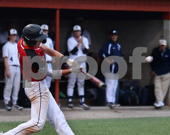 CARL RUSSO/staff photo Brett Dunham swings hard. North Andover defeated St. John's Prep in the Super 8 tourney championship game Tuesday night. 6/18/2019