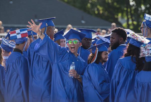 AMANDA SABGA/Staff photo<br /> <br /> Graduates gesture to family and friends during Methuen High School's 2019 graduation ceremony on Nicholson Stadium.<br /> <br /> 6/7/19