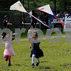 TIM JEAN/Staff photo<br /> <br /> Twin sisters Victoria, left, and Brooke Alejandro, both 4, of Lawrence run with their kites they made during the 6th annual S.A.L.S.A Festival at Riverfront Park in Lawrence.   The S.A.L.S.A. event (Supporting Active LifeStyles for All) featured free family fun games, kite making and flying, trolley rides, boat rides, music and a healthy lunch. Local non-profits and government organizations combined efforts for the event. Organizations taking part were Groundwork Lawrence's Kite Festival, Lawrence Public Schools' Summer Meals Program Kickoff, and the Mayor's Health Task Force's Family Fun & Fitness Day into the fun-filled S.A.L.S.A. Festival. This event is supported in part by Columbia Gas, Massachusetts Cultural Council's Festivals Program, and by a grant from the Lawrence Cultural Council, a local agency which is supported by the Massachusetts Cultural Council, a state agency.  6/1/19